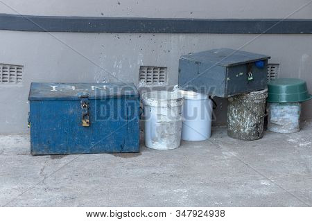 A Close Up View Of A Old Blue Workers Box That Has Locks To Keep It Closed And Conctruction Tools