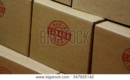 Made In Canada Stamp Printed On Cardboard Box. Factory, Manufacturing And Production Country Concept