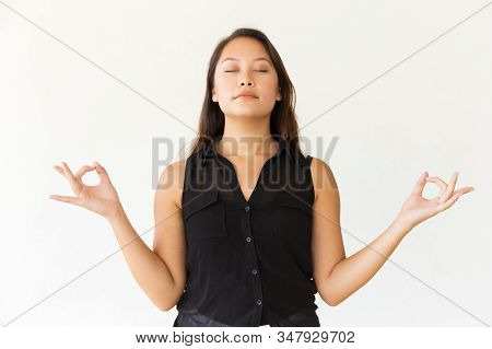 Relaxed Woman Meditating With Closed Eyes. Portrait Of Beautiful Calm Young Asian Woman Meditating W