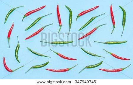 Red And Green Chili Peppers On Blue Table. Bright Food Flat Lay Pattern. Cooking Ingredients Creativ