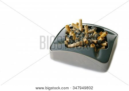 Metal Ashtray Full Of Cigarette Butts, Isolated On White Background, Stop Smoking, Bad Habit. Warnin