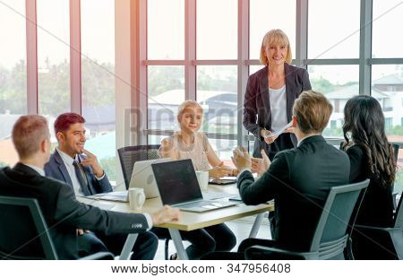 Manager Woman Or Leader Of Business Teams Discuss With Detail In The Document With Her Team And Plan