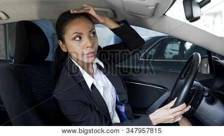 Successful Lady Boss Smartening Hairstyle Up, Looking Into Car Mirror, Beauty
