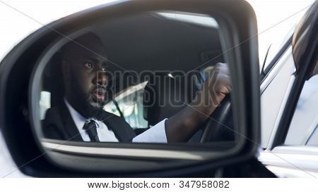 Tensed African American Male Driving Car, Escaping Pursuit, Traffic Rules
