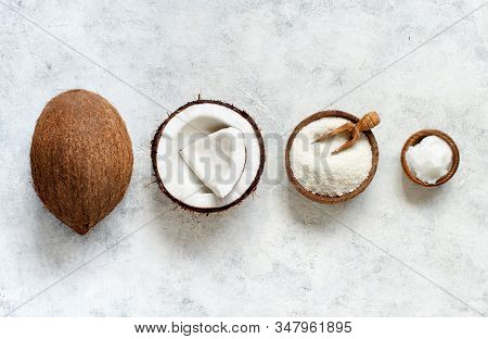 Coconut Flour And Coconut Oil With Coconut Pieces Top View