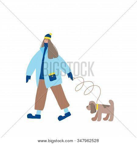 Cute Girl Dressed In Loose Trendy Clothes Walking With Her Dog. Female Teenager Wearing In Cozy Coat