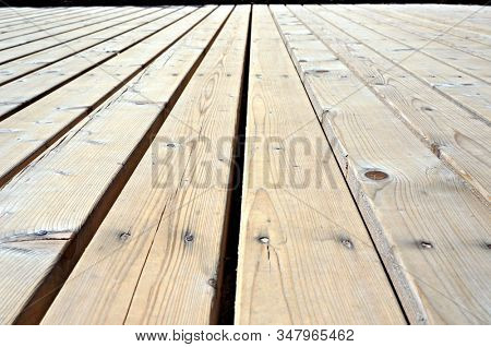 Boards of wood covering. Timber flooring planks. Diminishing perspective view.