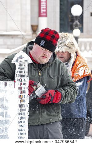 St. Paul, Mn/usa - January 25, 2020: Ice Sculptor At Multi-block Ice Carving Competition Using Grind