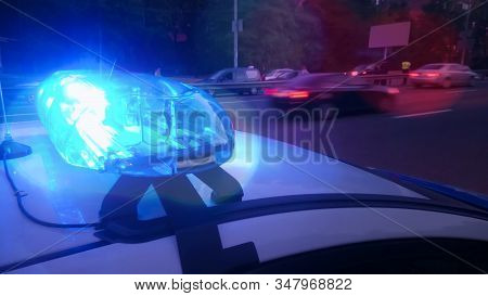Closeup Blinking Strobe Lights On Police Car, Blue Lightbar, Emergency Situation