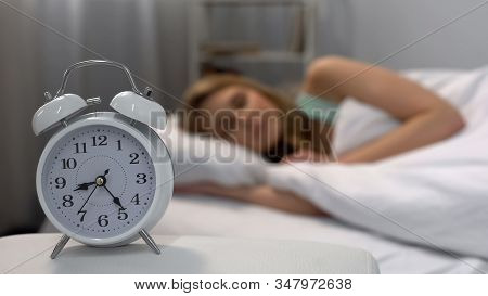 Woman Oversleeping In Morning, Alarm Clock Ringing Near Bed, Daily Routine