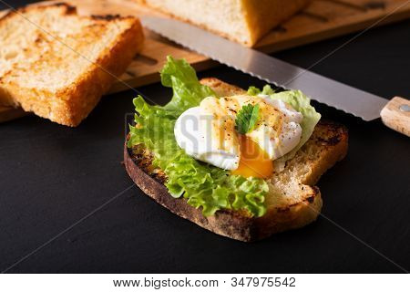Organic Food Breakfast Concept Homemade Poached Egg Or Eggs Benedict On Sourdough Bread Toasted On B