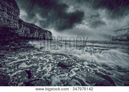 Dark cloud and rain at sea
