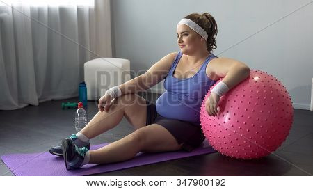 Self-confident Lady Delighted With Successful Workout, Dreaming About New Dress