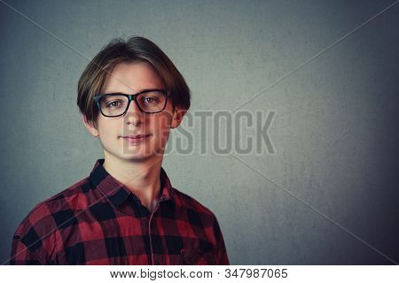 Close Up Portrait Of Positive Boy Adolescent Wearing Red Shirt And Eyeglasses Looking Cheerful To Ca