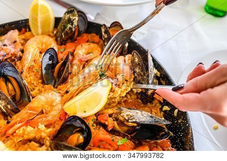 Spanish Seafood Paella Rice Dish With Fresh Shrimp, Scampi, Mussels, Squid, Octopus And Scallops Ser