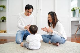 Happy Asian Family Of Three, Young Father And Mother Playing Games And Clapping Hands With Baby Boy