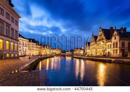 poster of Travel Europe Belgium background - Ghent canal, Graslei and Korenlei streets in twlight the evening. Ghent, Belgium