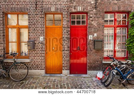 Doors of old houses and bicycles in european city. Bruges (Brugge), Belgium