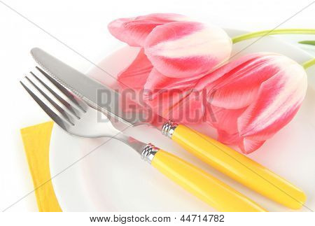 Festive dining table setting with tulips isolated on white
