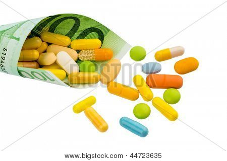 tablets and one hundred euro banknote symbolic photo: cost of medicine and drugs in the pharmaceutical industry