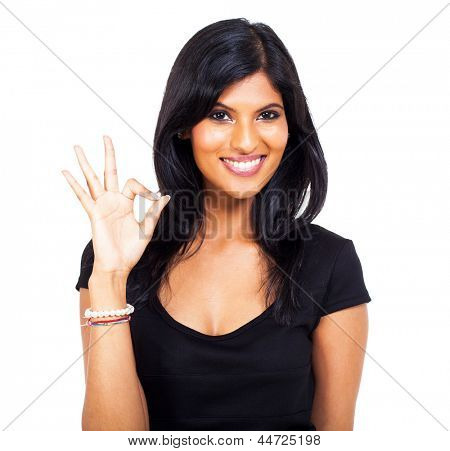 cheerful indian woman giving ok hand sign on white background