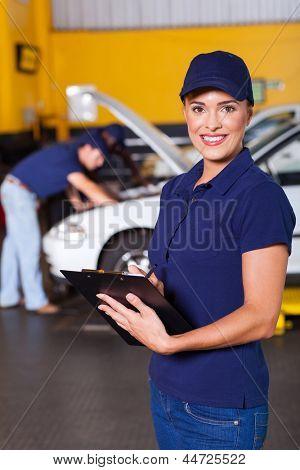 beautiful female garage receptionist inside workshop