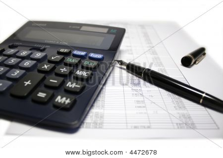 Calculator And Pen On Balance Sheet