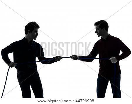 two caucasian young men tug of war  in shadow  white background