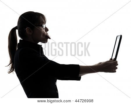 one business woman computer computing tongue out digital tablet  silhouette studio isolated on white background