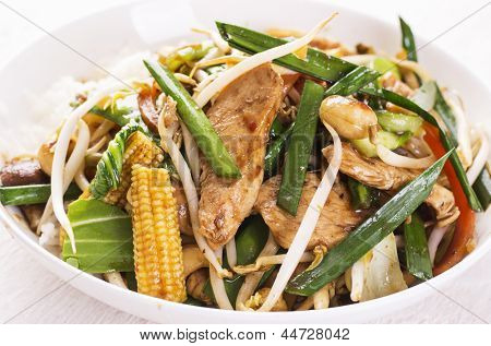chicken with vegetables fried in wok