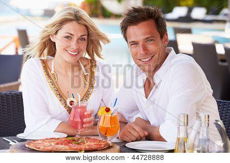 Couple Enjoying Meal In Outdoor Restaurant