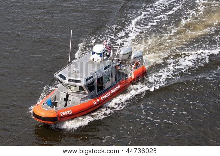 JACKSONVILLE, FLORIDA - MARCH 17: A US Coast Guard 25 Foot Defender Class Boat patrolling the waterways of Jacksonville, Florida on March 17, 2013. These boats first began service in May 2002.