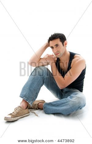 Handsome Guy Sitting On Floor