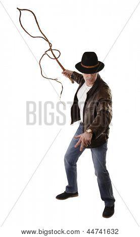 Adventurer treasure hunter is swinging with bull whip