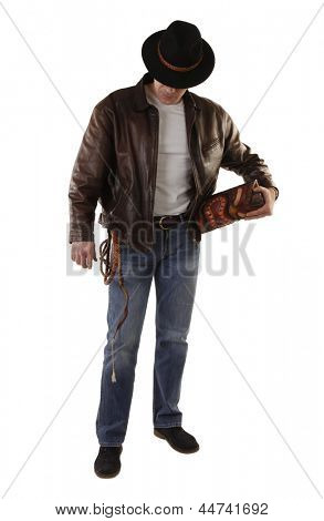 Adventurer treasure hunter with whip and ancient idol