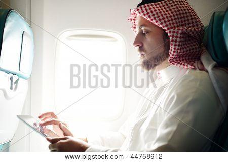Arabic businessman working on tablet computer