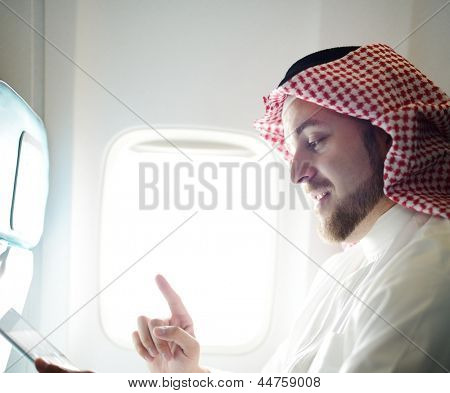 Arabic businessman working on tablet computer poster