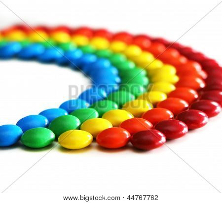 Colorful candies in raindow colors and shape poster