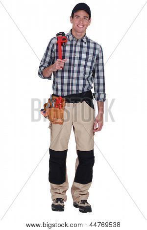 Clean-cut tradesman holding a pipe wrench
