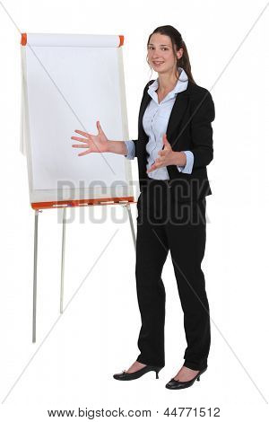 Enthusiastic businesswoman with a flipchart