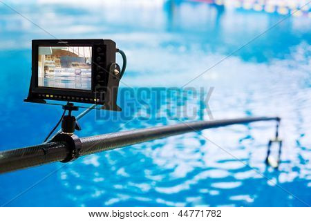 Portable multiformat LCD monitor, mounted on rod for shooting jumps into water