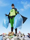 Eco superhero holding two plastic bags full of domestic trash standing on garbage heap - waste segregation concept poster