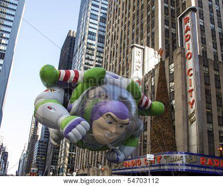 Buzz Lightyear balloon passing Radio City Music Hall