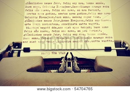 happy new year written in different languages with an old typewriter, with a retro effect