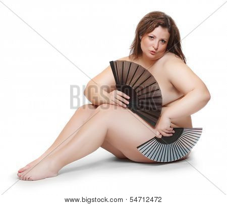 Naked overweight woman with oriental fan isolated on a white background.