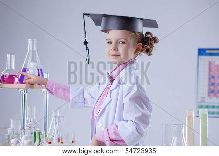 Cute little laboratorian posing in graduate hat