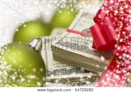 Stack of One Hundred Dollar Bills with Red Bow Near Green Christmas Ornaments on Snow Flakes with Snow Flake Border.