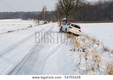 White Suv Crashed In A Country Road Kerbside