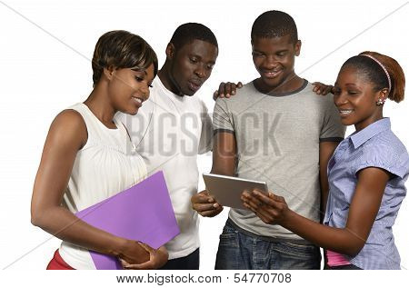 Four African Friends Looking At Tablet Pc