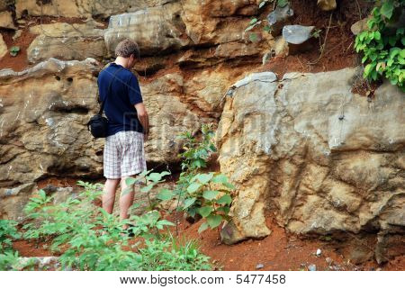Young Man Peeing In The Nature